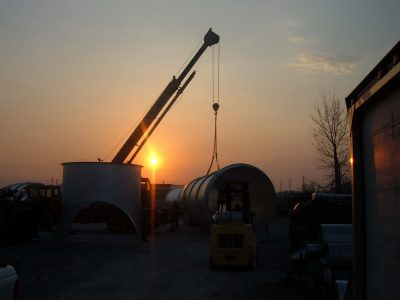 Crane hoists a 10' Diameter Pipe