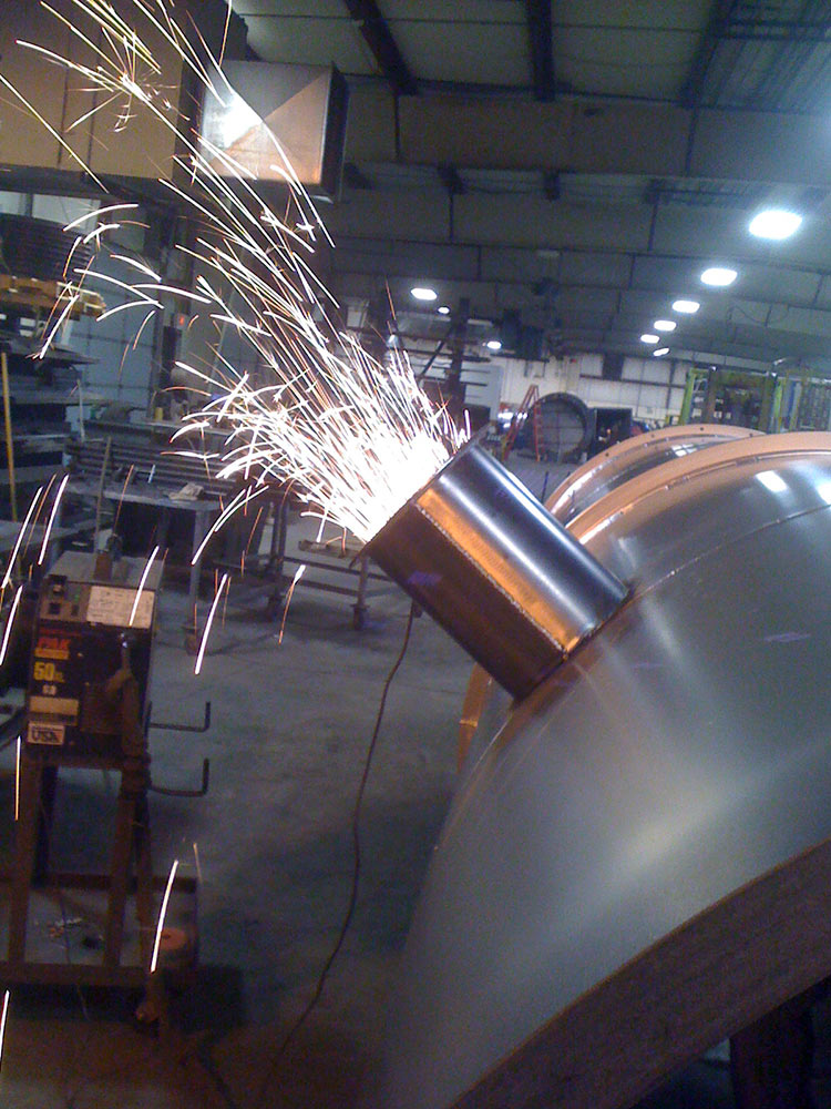 Sparks fly from Grinding Custom Fab Work